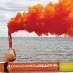 Orange smoke flare